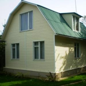 Обшитый сайдингом с теплоизоляцией дом